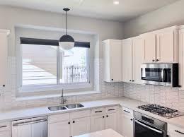 white kitchen cabinets with hexagon backsplash elongated hexagon white