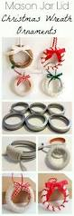 diy christmas wreath ornaments from repurposed mason jar lid rings