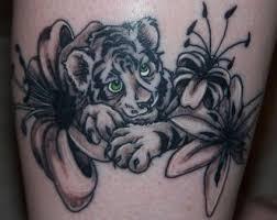 tiger cub and flower from itattooz