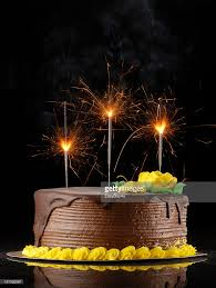 birthday cake sparklers chocolate birthday cake with sparklers on a black background stock