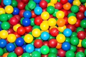 lots of colorful plastic balls in the pool for children to play