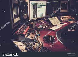 recording studio workstation desk closeup boutique recording studio control desk stock photo
