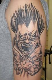 simple evil tattoo men upper sleeve cover up with simple grey ink scary clown with dice