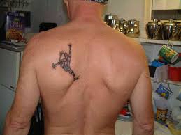 skeleton climbing tattoo on side in 2017 real photo pictures