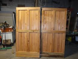 Double Barn Doors by Well Liked Double Pine Wood Barn Doors For Homes With Four Panels