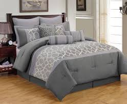bedroom light wooden flooring plus grey comforter also white wall