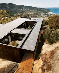 8 modern roof designs dwell hillside home with stained plywood
