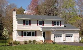 a middle class colonial house on a sunny day stock photo picture