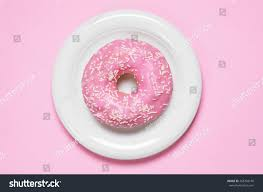 donut covered icing plate top view stock photo 468768140