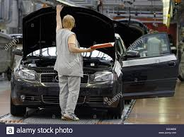 audi factory dpa a woman looks under the bonnet of a new audi a3 at the audi