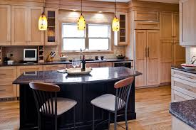 maple cabinets with black island kitchen encounters md award winning kitchen and bath design and