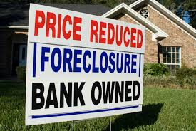 us foreclosures fall in april even as banks reclaim more homes