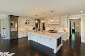 kitchen island panels white kitchen with gray mirrored refrigerators transitional