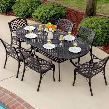 White Patio Dining Table by Heritage 7 Piece Cast Aluminum Patio Dining Set With Oval Table By