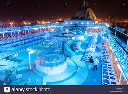 p u0026o oceana pool deck lite up at night with coloured lights las
