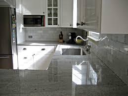 hampton carrara backsplash kashmir white counters involving home