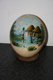 painted ostrich egg painting on front of an ostrich egg painting by colleen daniel