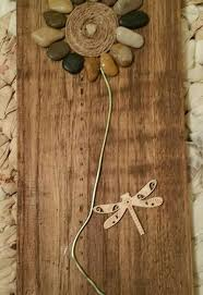 wall decor made of wood indoor flowers on pallet wood made of stones and such hometalk