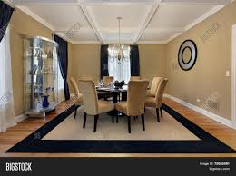 dining room with tan walls and blue drapes stock photo u0026 stock