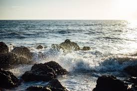 rocky shore wallpapers photo of blue ocean wave coming to the rocky shore free stock photo