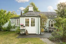 this fanciful allotment hut in denmark has a tiny bedroom a