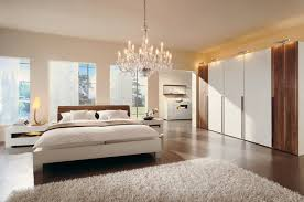 bedroom chandelier size trends and for with tufted images white gallery of bedroom chandelier size trends including choosing in dining images elegant design cozy king bed frame and white gray blanket also pillows combine