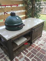 the big green egg table with concrete top and barn door