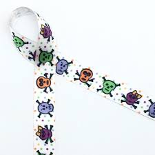 black and purple halloween background skulls and crossbone ribbon on 5 8