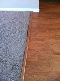 tn carpet transition to wood damage