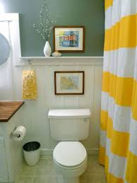 diy small bathroom decor wall painting and striking yellow curtain