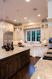 adding cabinets on top of existing cabinets kitchen with mix of dark wood and cream cabinets could the little
