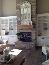 stone and brick applications with dark wood floors hearth and