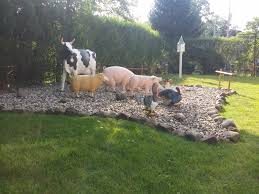 stone landscaped bed with farm animals almost perfect landscaping
