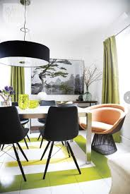 modern small dining roomwith black chairs big pendant lamp orange