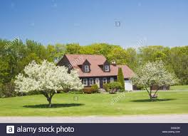 cape cod style house in spring maine stock photo royalty free