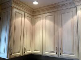 White Kitchen Cabinets With Glaze by Glazed Kitchen Cabinet Makeover Here A Dark Kitchen Is Painted