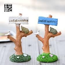 kawaii boy and miniature figurines