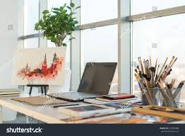 designer desk painter workplace order side view designer stock photo 657590488