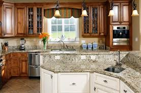 dark lower cabinets light upper cabinets kitchen cabinets light on