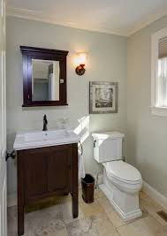 traditional half bath remodel crown molding tile floor medicine