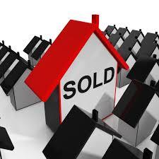 how to sell your house for the most money man opening door with