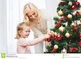 happy family decorating christmas tree at home stock photo image