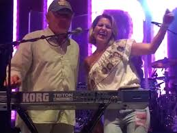 candace cameron bure dances on stage with the beach boys