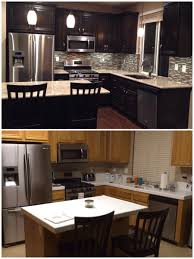 wood countertops kitchens with dark cabinets lighting flooring