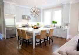 white kitchen island with seating 30 kitchen islands with tables a simple but clever combo