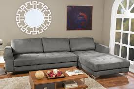 living room grey leather sectional with brown wooden floor and