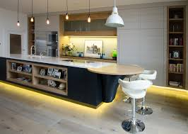 led kitchen cabinet lighting featuring dark brown varnished wooden