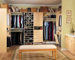 traditional closet with upholstered bench by tony leocadio