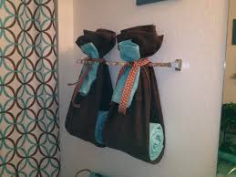 ways to decorate the towel racks in your bathroom upstairs
