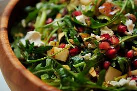arugula pear and goat cheese salad with pomegranate vinaigrette